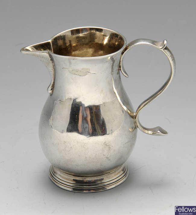 A George II silver sparrow beak cream jug.