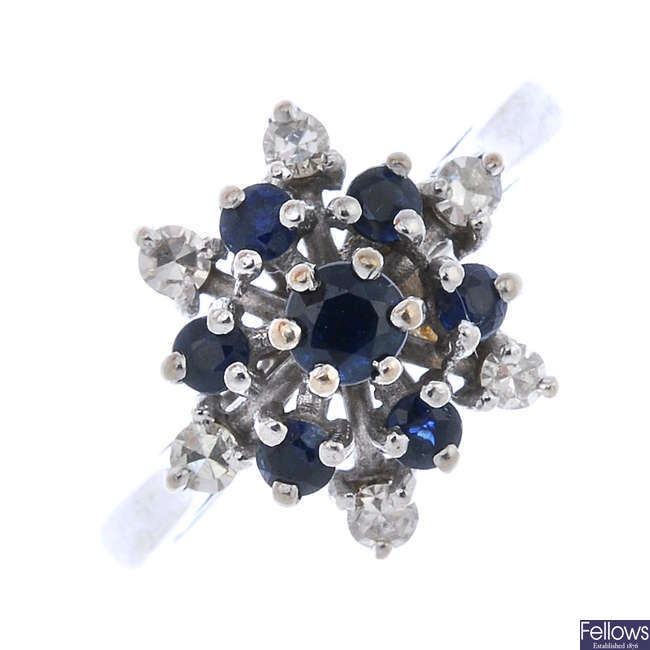 A sapphire and diamond star cluster ring.