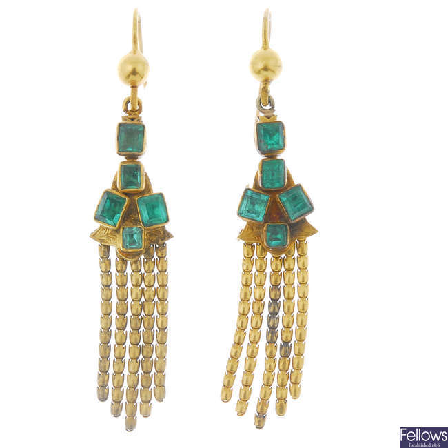 A pair of late 19th century 18ct gold emerald ear pendants.