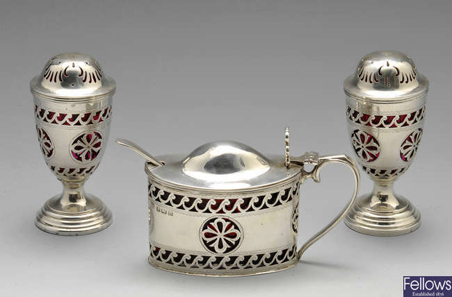 An early twentieth century three piece silver condiment set.