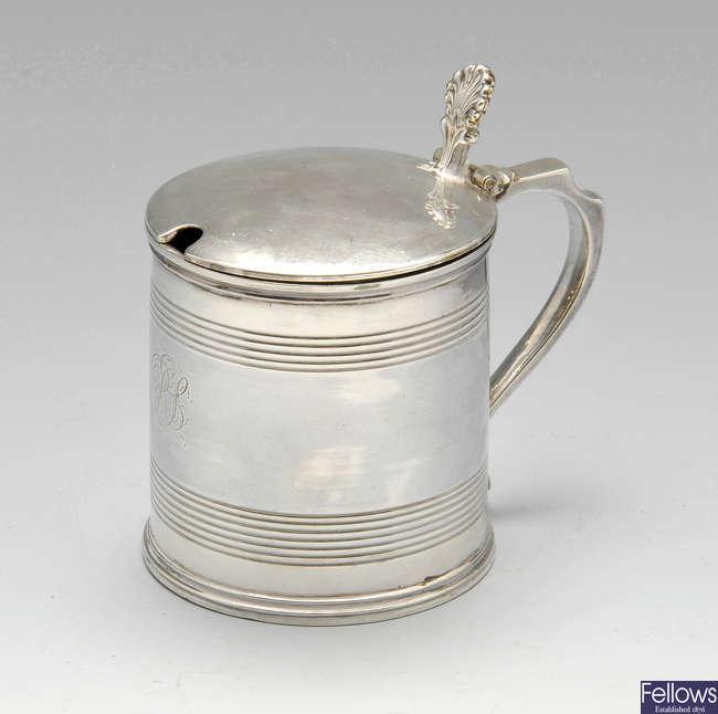 A George III provincial silver mustard pot of tankard form.