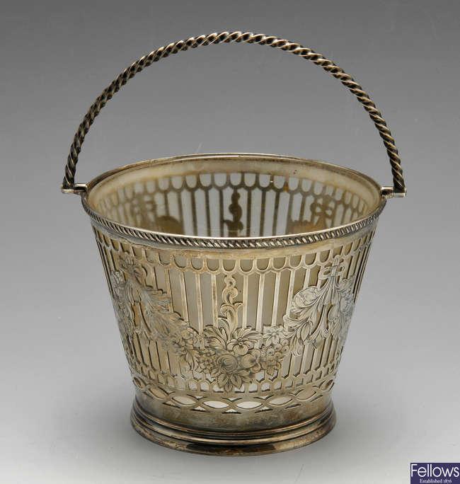A Victorian silver sugar basket.