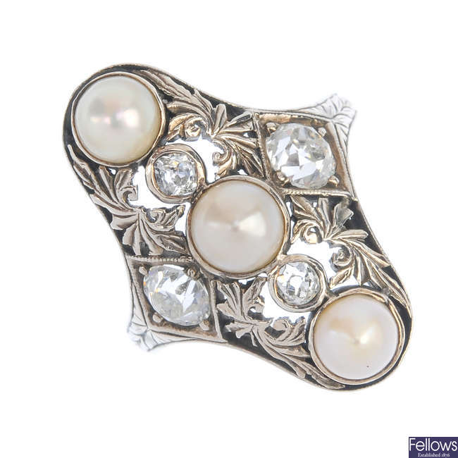 An early 20th century gold split pearl and diamond dress ring.