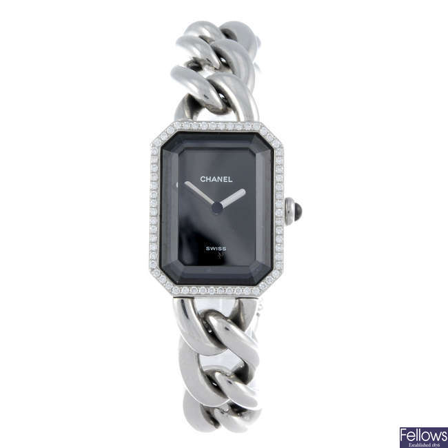 (538092-7-A) CHANEL - a lady's stainless steel bracelet watch with two other watches.