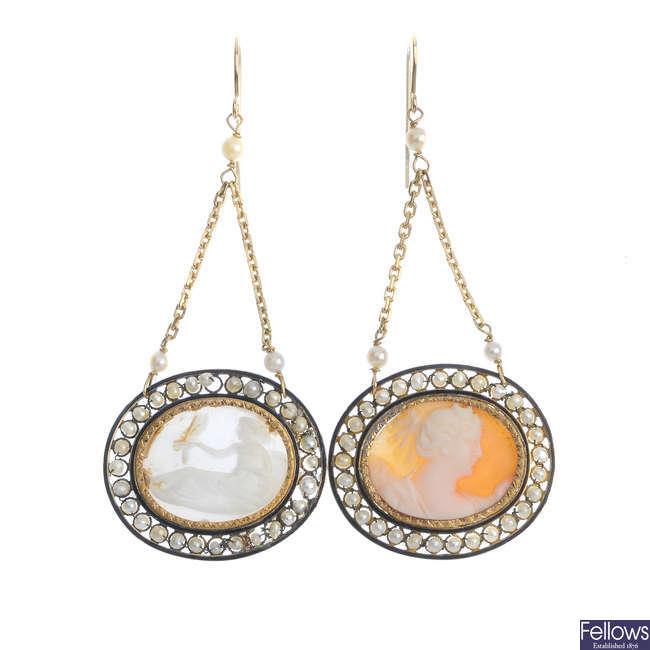 Two shell cameo ear pendants.