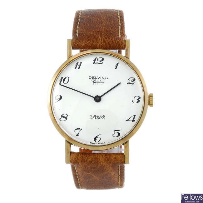 DELVINA - a gentleman's 9ct yellow gold wrist watch.