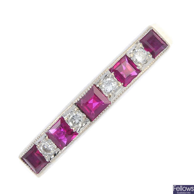 An 18ct gold ruby and diamond half-circle eternity ring.