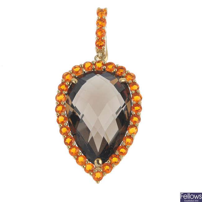 A 9ct gold smoky quartz and fire opal pendant.