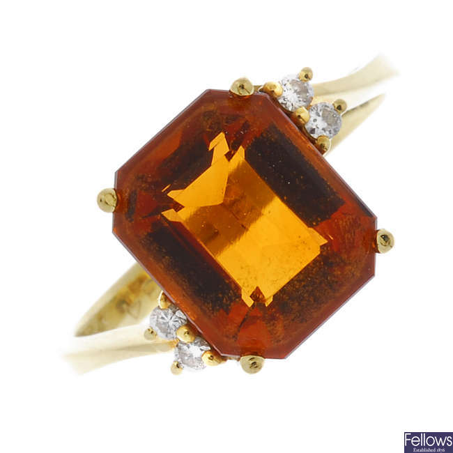 A citrine and diamond dress ring.