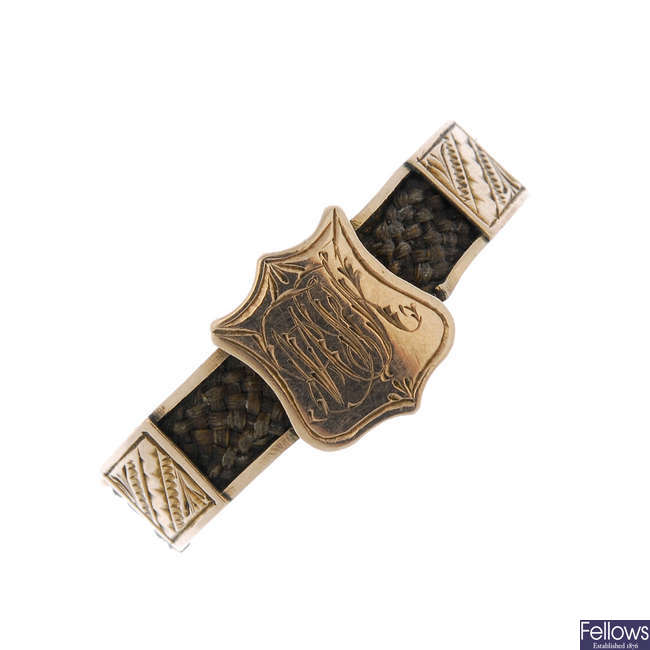 An early 20th century 9ct gold memorial ring.