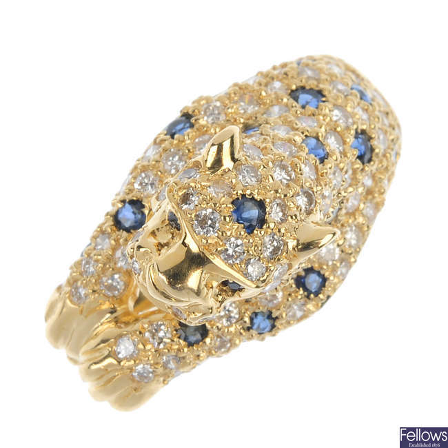 An 18ct gold diamond and sapphire leopard ring.