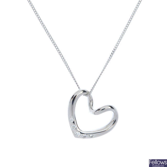An 18ct gold diamond heart pendant, with chain.