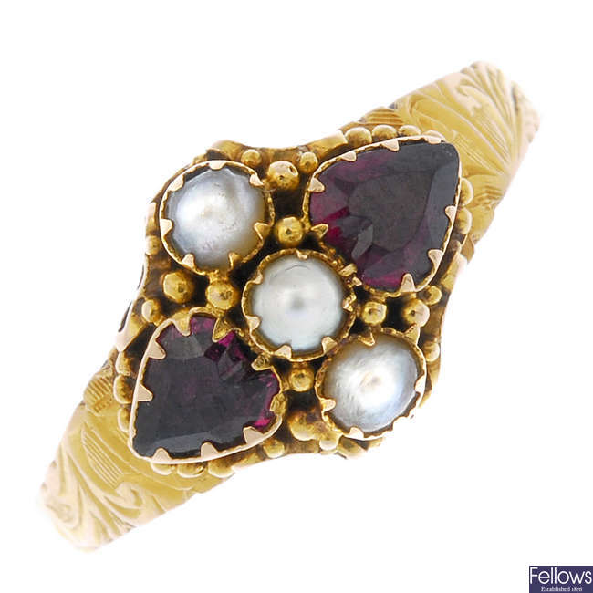 A late Victorian 15ct gold garnet and split pearl ring.