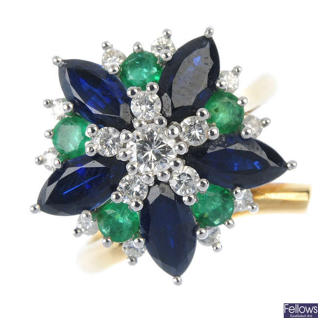 A diamond and gem-set floral cluster ring.