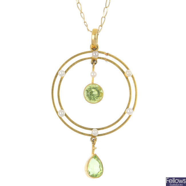 An early 20th century 15ct gold peridot and seed pearl pendant.