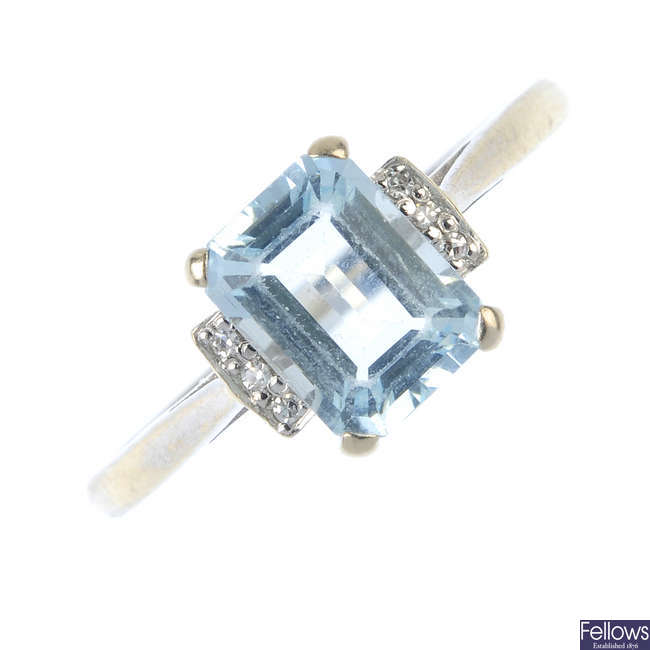 An 18ct gold aquamarine and diamond dress ring.