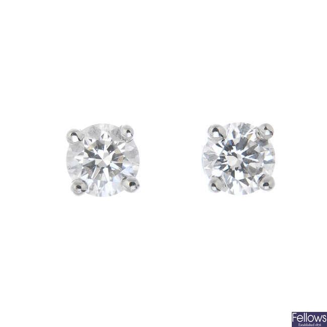 TIFFANY & CO. - a pair of brilliant-cut diamond single-stone ear studs.