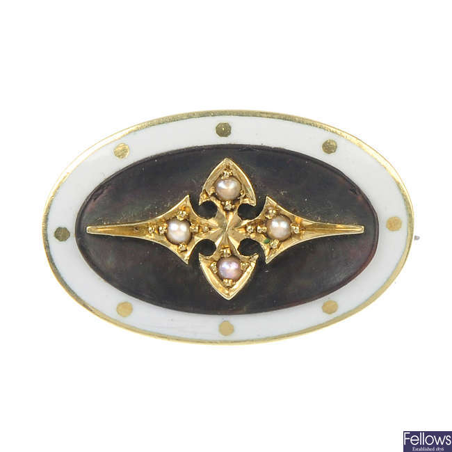 A late 19th century gold, enamel and mother-of-pearl brooch.
