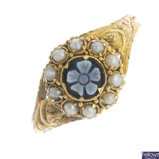 A mid Victorian 15ct gold hardstone and split pearl memorial ring.
