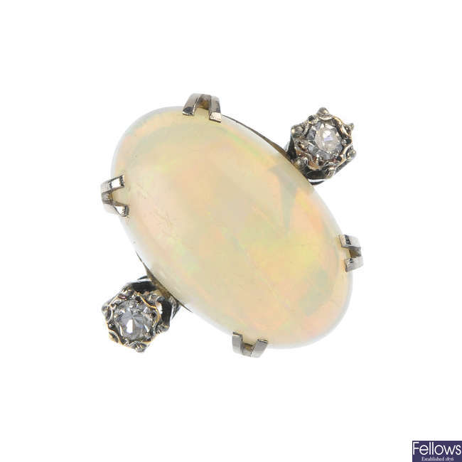 A mid 20th century 9ct gold and platinum opal and diamond ring.
