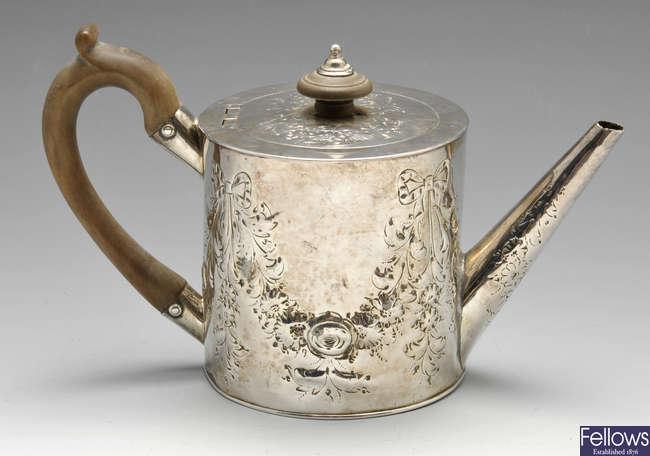 A late George III silver teapot.