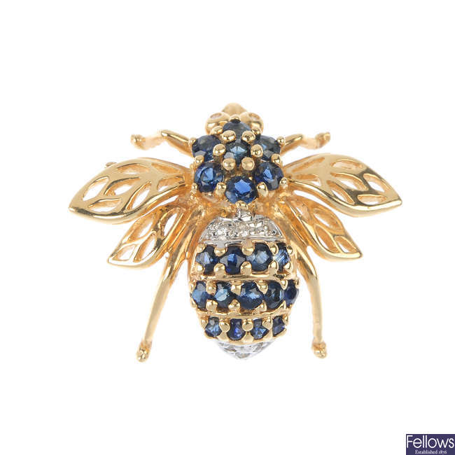 A sapphire and diamond bee brooch.