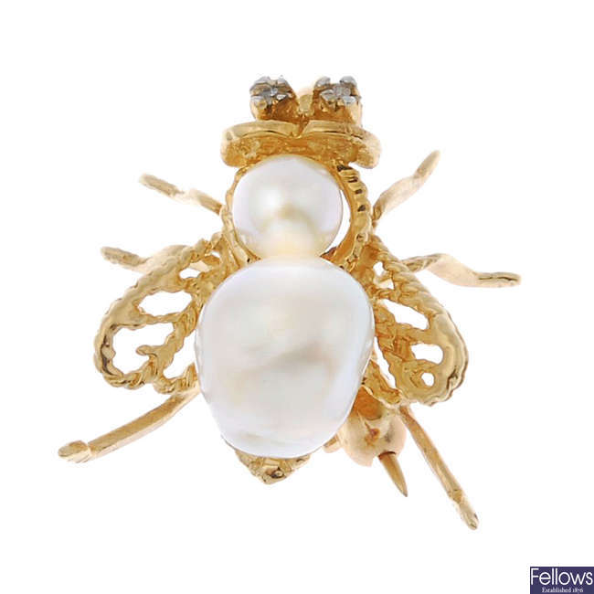 A cultured pearl and diamond fly brooch.