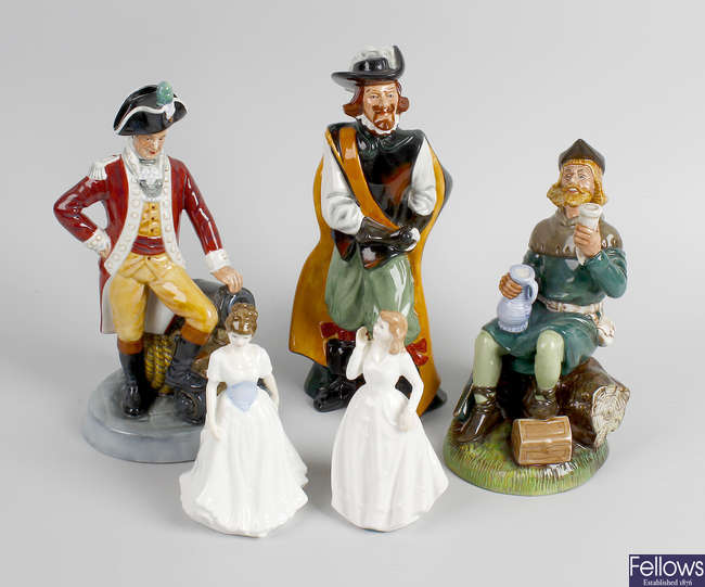 A group of five Royal Doulton figures.