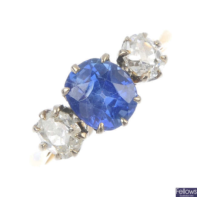 An early 20th century 18ct gold sapphire and diamond three-stone ring.