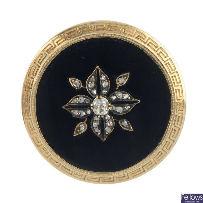 A late 19th century gold diamond and onyx brooch.
