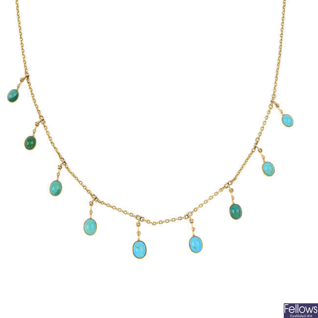 A composite early 20th century gold turquoise fringe necklace.