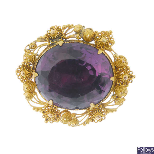 A late 19th century gold and amethyst brooch.