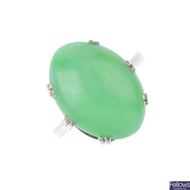 A mid 20th century gold jade single-stone ring.