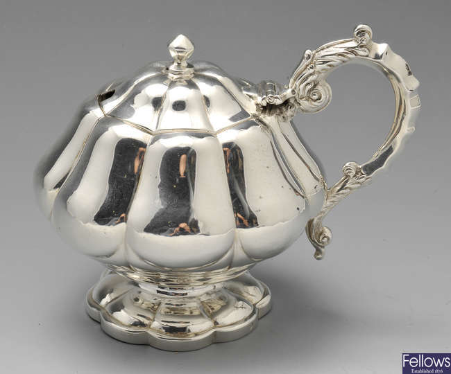 An early 19th century silver mustard pot.