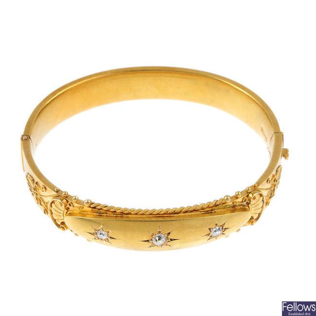 An early 20th century 15ct gold diamond bangle.