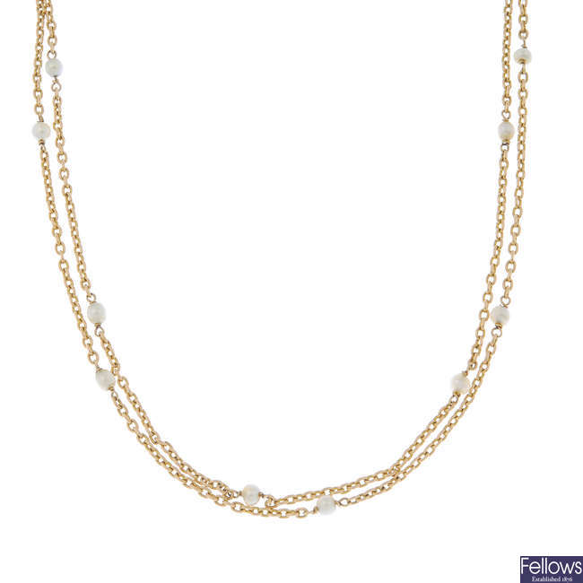 An early 20th century 9ct gold cultured pearl longuard chain.