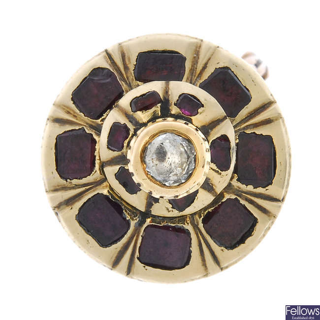 A late 19th century gold garnet and diamond cluster ring.