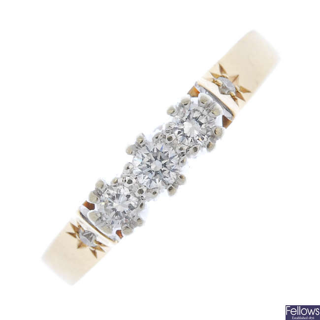 A 9ct gold diamond three-stone ring.