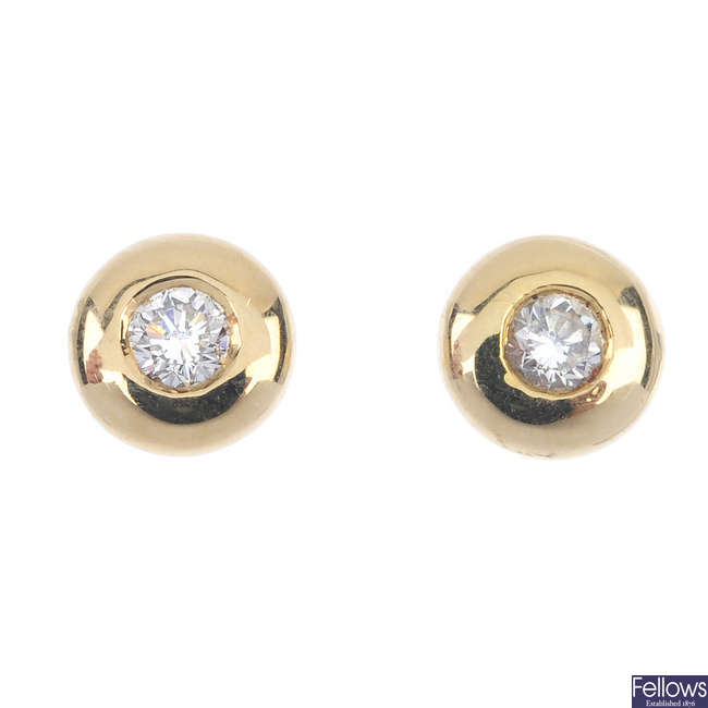 A pair of 18ct gold diamond single-stone ear studs, by Mappin & Webb.