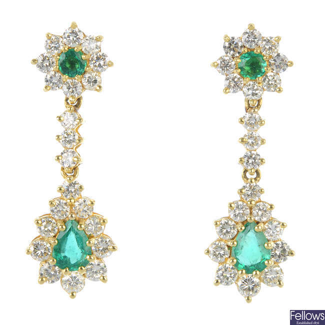 A pair of emerald and diamond cluster ear pendants.