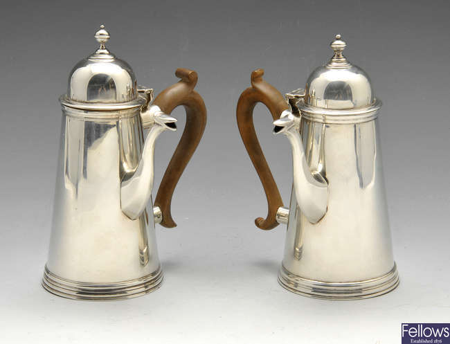 A pair of Edwardian silver chocolate pots.
