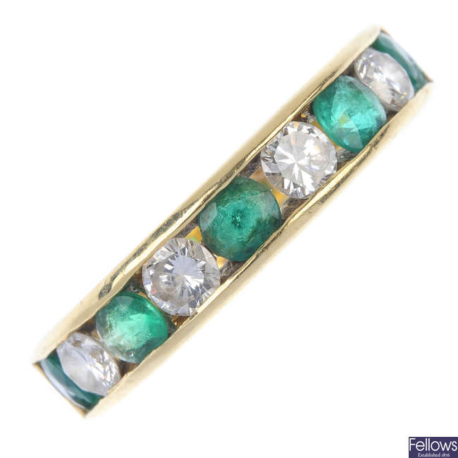 An 18ct gold diamond and emerald half-circle eternity ring.