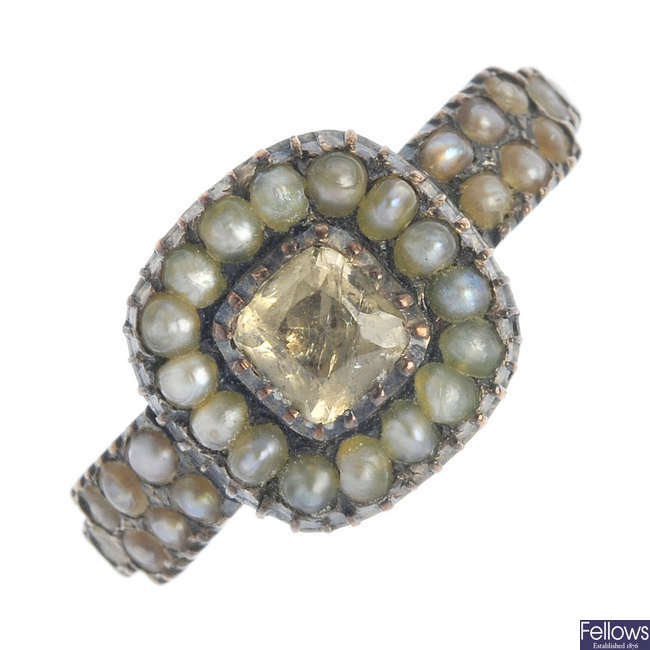 An early 19th century gold topaz and split pearl ring.