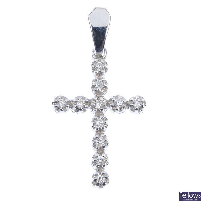 A diamond cross pendant and a fleur-de-lys pendant.