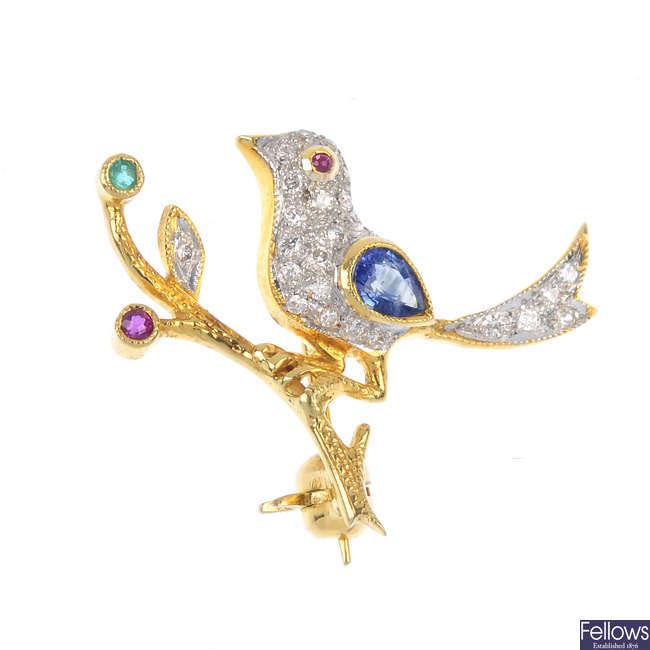 A diamond and gem-set bird brooch.