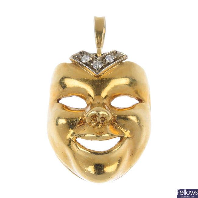 A diamond mask pendant.