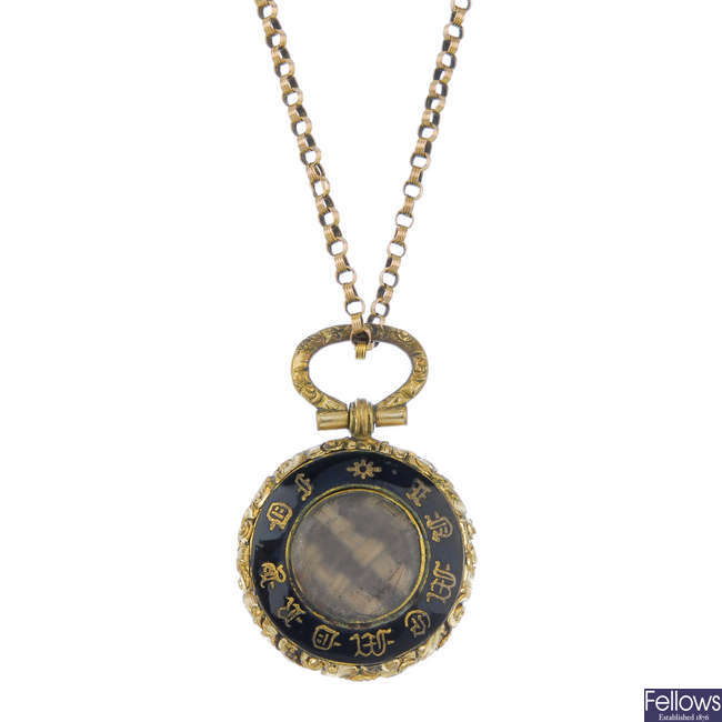 A late 19th century enamel memorial locket and 9ct gold chain.
