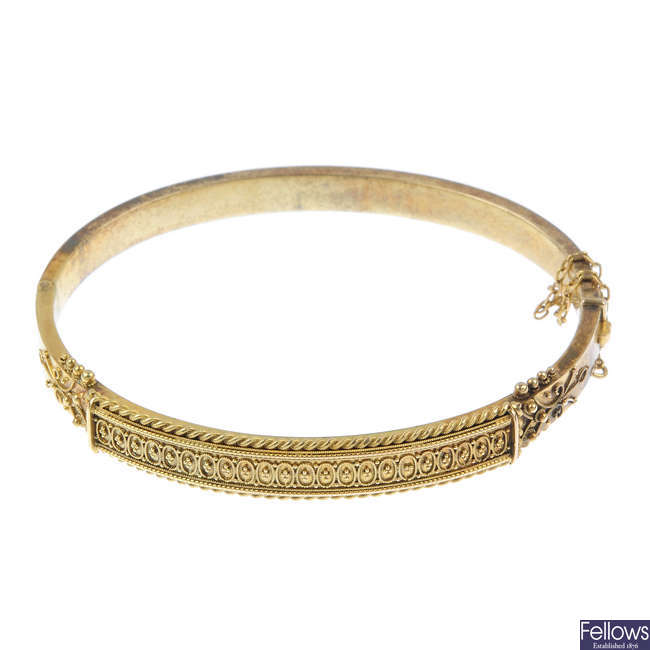 A late 19th century gold hinged bangle.