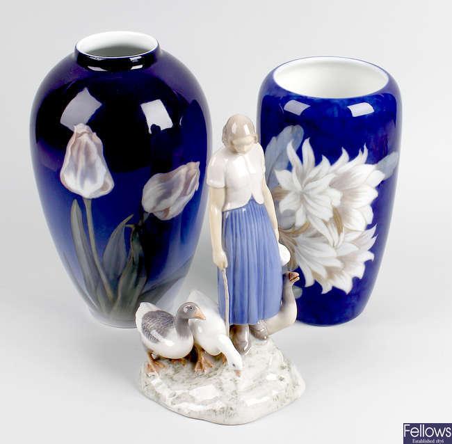 A Bing & Grondahl figure, plus two Royal Copenhagen porcelain vases.