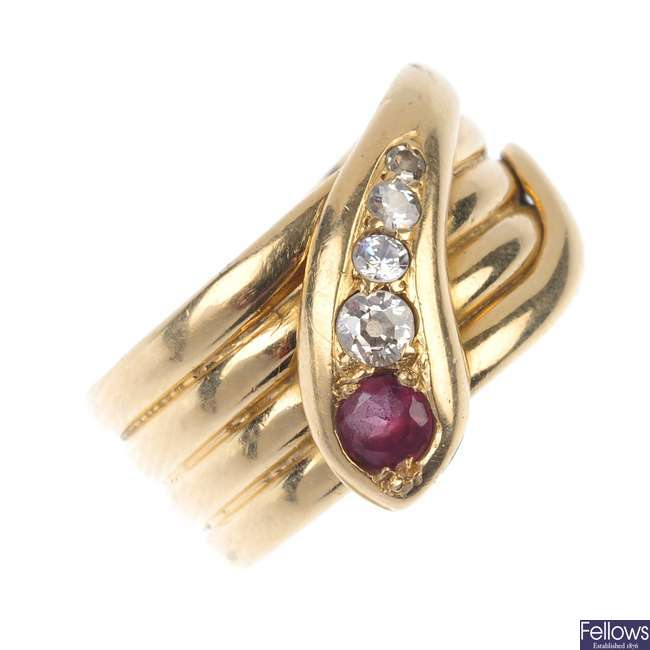 An early 20th century 18ct gold garnet and diamond snake ring.
